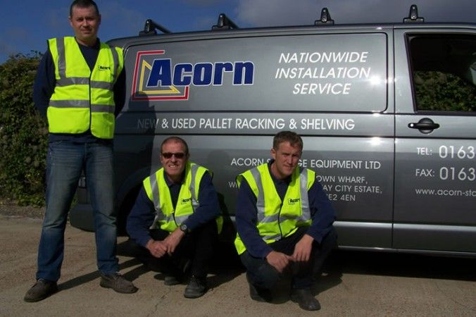Acorn Storage Team Next to Van